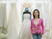 Young woman standing in a bridal boutique — Stok fotoğraf