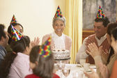 Family birthday party for Hispanic grandmother — Stock Photo