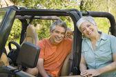 Senior Hispanic couple with jeep — Stock Photo