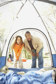 African American mother and daughter camping — Stock Photo