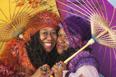Two senior African women holding parasols — Stock Photo