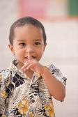 Young boy with finger over mouth — Stock Photo