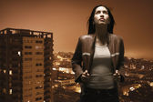 Woman overlooking urban area — Stock Photo