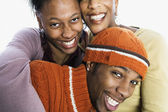 Portrait of mother with teenage children — Stock Photo