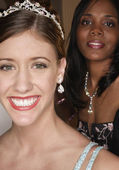 Teenage girls smiling for the camera in evening gowns — Stock Photo