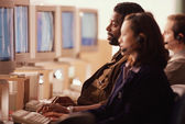 Multi-ethnic businesspeople working in call center — Stock Photo