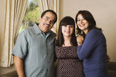Portrait of Hispanic family hugging — Stock Photo