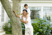 Portrait of father carrying son on shoulders — Stock Photo