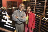 Portrait of couple in wine cellar — Stock Photo