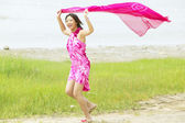 Portrait of woman running on beach — Stock Photo