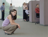 Businesswoman squatting on the floor of office — Stock Photo