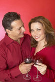 Hispanic couple drinking red wine — Stock Photo