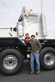 Father standing with his son by their truck — Stock Photo