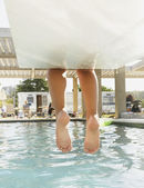 Feet dangling off the end of a diving board — Stock Photo