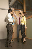 Businesspeople jumping for joy — Stock Photo