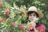 Portrait of woman holding gardening gloves — Stock Photo