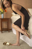 Woman putting high heels on — Stock Photo