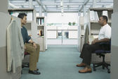 Two businessmen sitting in office — Stock Photo