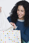 Young woman admiring new purchase — Stock Photo
