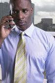 African businessman using cell phone — Stock Photo