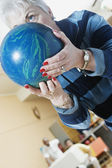 Close up of woman with bowling ball — Stock Photo