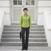 Portrait of businesswoman on steps — Stock Photo