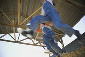 Low angle view of children jumping in hay — Stock Photo