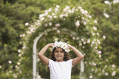 Young Hispanic girl with flower garland on head — Stock Photo