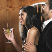 Multi-ethnic couple with martini — Stock Photo