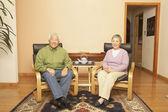 Senior Asian couple having tea — Stock Photo