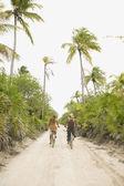 Couple riding bikes on sandy path — Stock Photo