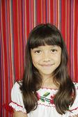 Young girl smiling at camera — Stock Photo