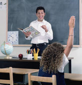 School girl raising her hand in class — Stock Photo