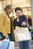 Mixed Race women with shopping bags — Stock Photo