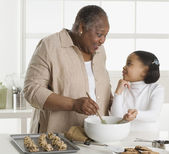 Senior woman making cookies with her granddaughter — Stock Photo