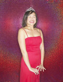 Asian woman wearing evening dress and tiara smiling — Stockfoto