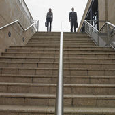 Low angle view of businesspeople at the top of a staircase — Stock Photo