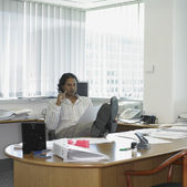 Indian businessman at his desk — Stock Photo