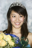 Young woman wearing tiara holding bouquet — Stock Photo