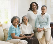 Multi-generational African women sitting on sofa — Stock Photo
