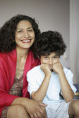 Middle-aged woman and grandson smiling for the camera — Stock Photo