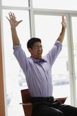 Asian businessman cheering in office — Stock Photo