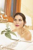 Young woman posing in bubble bath — Stock Photo