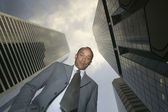 Low angle portrait of businessman looking down — Stock Photo