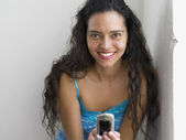 Portrait of young woman with cell phone — Stock Photo