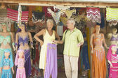 Senior couple looking at belly dancing outfits — Stock Photo