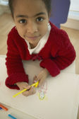 High angle view of African girl drawing — Stock Photo