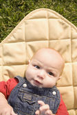 High angle view of baby laying on blanket — Stock Photo