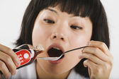 Asian woman taking Chinese medicine — Stock Photo