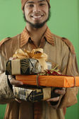 Man with wrapped gifts — Stock Photo
